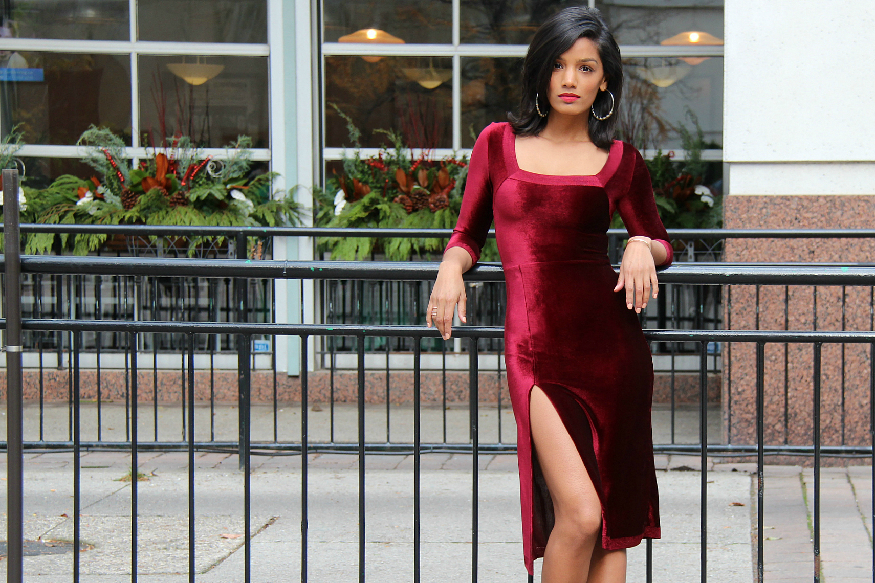 Sweet Shard DIY Red Velvet Dress High Slit. Medium-Wide shot of Sharadha wearing dress.