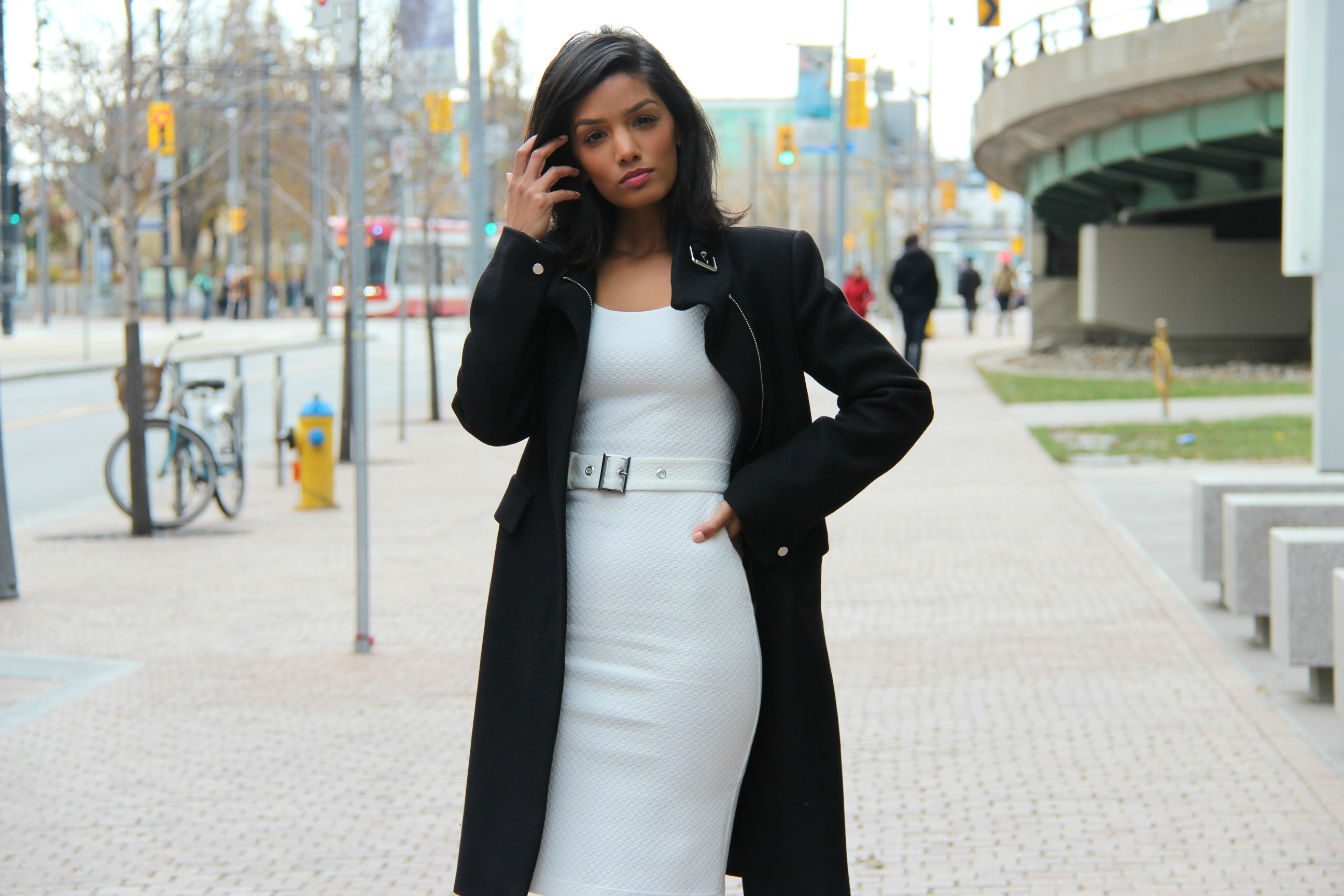 DIY Fitted White BodyCon Dress With Belt. Sharadha wearing black winter coat over top.