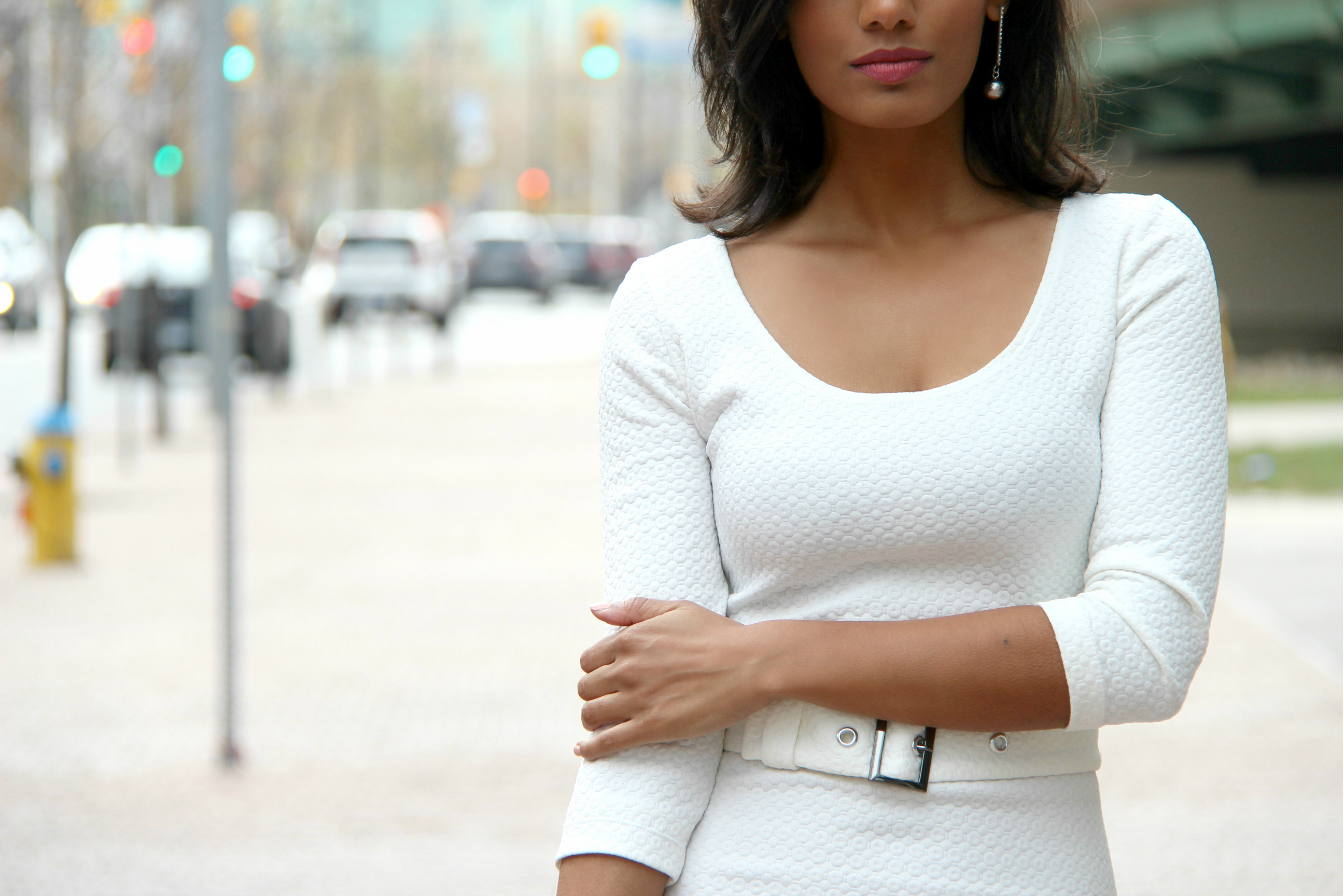 DIY Fitted White BodyCon Dress With Belt. Medium shot from waist up.